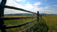 It is landscape of wooden fence in small village video
