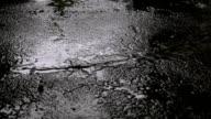 it is raining. the destruction of the asphalt video