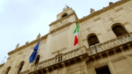 Italian and European flags on the historic building of Town Hall of Padua video