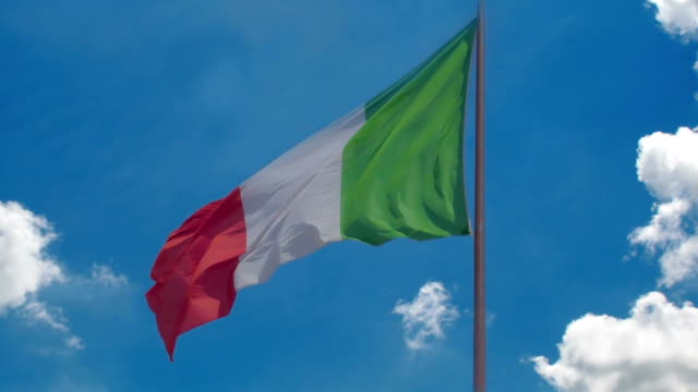 Italian flag flying against blue sky background, country's national symbol video