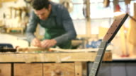Italian man working as artisan in guitar workshop video