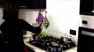italian woman preparing condiment for pasta video