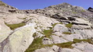 Italy Alps mountains aerial on rocky side in summer sunny day. 4k drone side flight wide establishing shot video