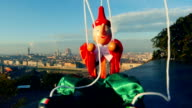 Italy Florence puppet Pinocchio sits in front of city landscape video