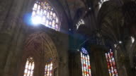 italy milan city duomo cathedral sun light stained-glass window interior panorama 4k video