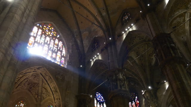 italy milan duomo cathedral sun light stained-glass window interior panorama 4k video