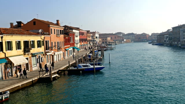 Italy, Murano, water boats canal and traditional buildings video