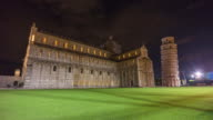 italy night famous pisa cathedral and tower duomo square side panorama 4k time lapse video