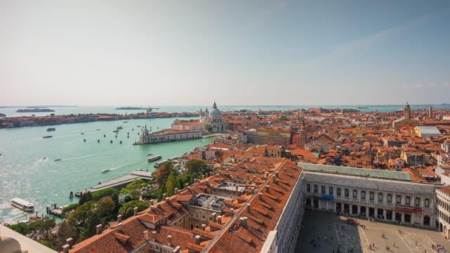 italy san marco campanile santa maria della salute basilica sunny panorama 4k time lapse venice video