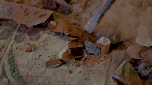 SLO MO Jackhammer's chisel removing tiles video