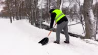 Janitor clean sidewalk from the snow in winter video