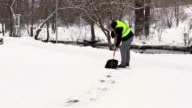 Janitor cleaning pavement from snow video