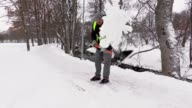 Janitor throw snow from the sidewalk video
