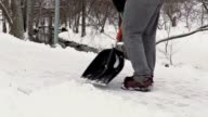 Janitor with snow shovel clean sidewalk from the snow video