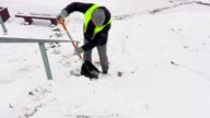 Janitor with snow shovel cleaning stairs video