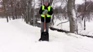 Janitor with snow shovel start cleaning path video