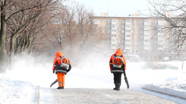 Janitors clean street Novodevichy Convent  pond video