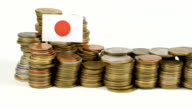 Japan flag with stack of money coins video