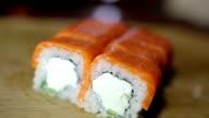 japan philadelphia maki roll with salmon. Luxury restaurant dish. Macro video