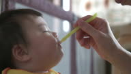 Japanese baby eating baby food by spoon. video
