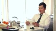 Japanese Businessman Business Man Using Ipad Digital Tablet During Breakfast video