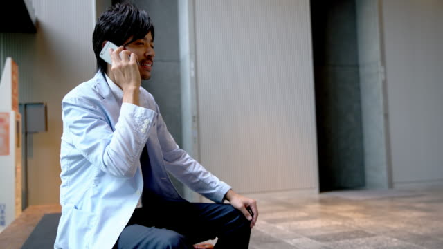 DS Japanese businessman talking on the phone video