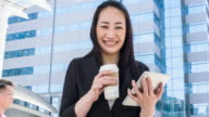 Japanese businesswoman using digital tablet in the street video