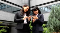 Japanese Businesswoman working on a portable devices video