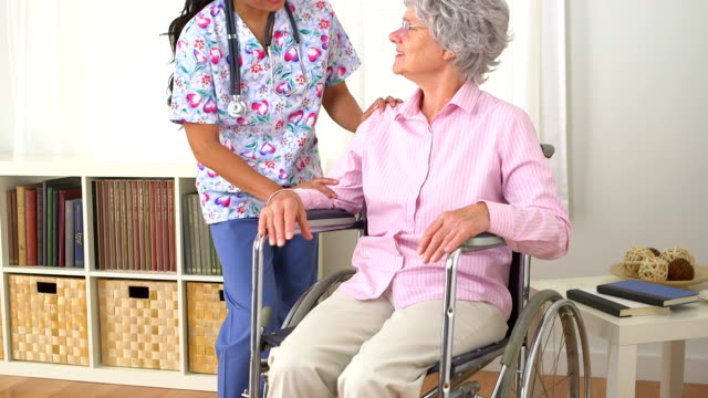 Japanese caregiver talking to patient video