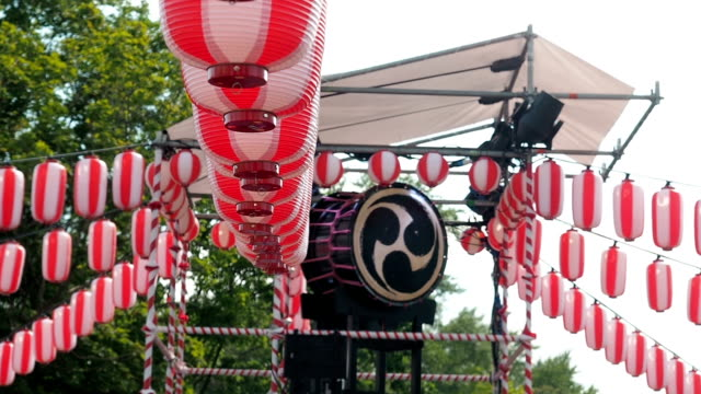 Japanese drum Taiko on the stage of the Yaguro. Paper red-white lanterns Chochin Scenery for the holiday Obon video