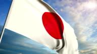 Japanese flag floating on sunset sky background video