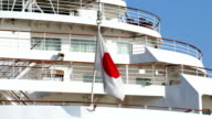 HD: Japanese flag in the stern of cruise ship (video) video
