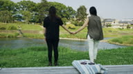 Japanese Gay Couple Holding Hands in Park video