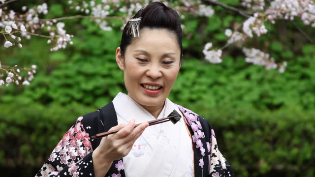 Japanese Kimono Woman Eating Sushi video