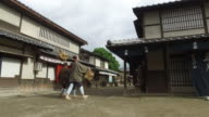 Japanese men walking down the village street video