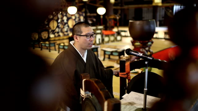 Japanese monk praying in a Japanese temple video