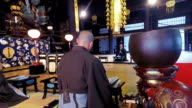 Japanese Monks Praying and Chanting in a Buddhist Temple video