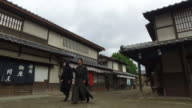 Japanese ninja and samurai walking down the village street video