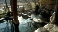 Japanese outdoor hot spring - slow motion video