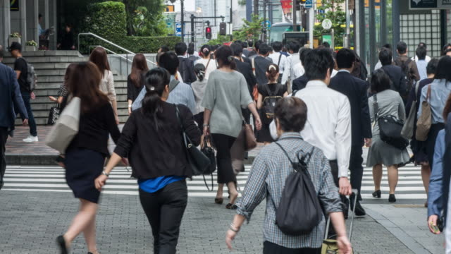 Japanese people commuting to work in Tokyo video
