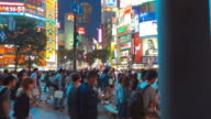 Japanese people crossing the street outside Shibuya station, Tokyo video