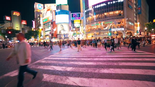 Japanese people crossing the street outside Shibuya station, Tokyo video