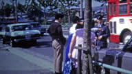 1972: Japanese police capture criminals in car accident. video