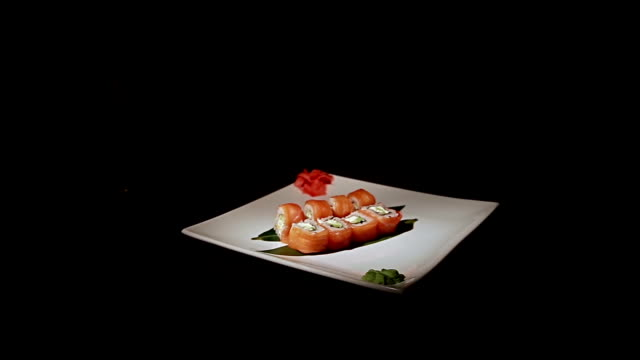 Japanese seafood sushi set on black background and fresh beer video