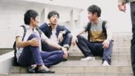 MS Japanese students having a break on steps video