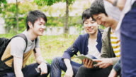 WS Japanese students relaxing in the park video