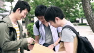 MS Japanese students using smartphone and digital tablet video