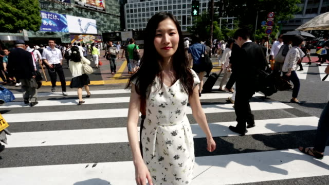 Japanese Woman Crossing Shibuya With Everyone Else Walking Backwards video