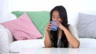 Japanese woman drinking coffee at home video