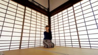 Japanese Woman Relaxing in a Traditional Screened Room video